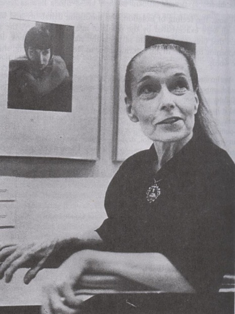 Brooks at an exhibition at Eastman House in 1984, beside Edward Steichen's 1929 portrait of her.