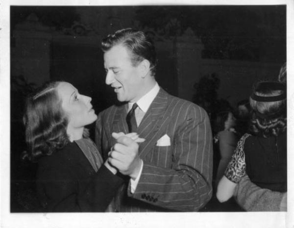 Brooks dancing with John Wayne at the wrap party for Overland Stage Raiders (1938), her last film
